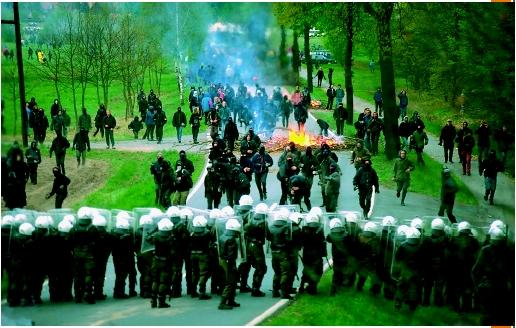 Police wearing riot gear form a human barricade against antinuclear demonstrators in Germany, May 7, 1996. (© Regis Bossu/Corbis Sygma. Reproduced by permission.)