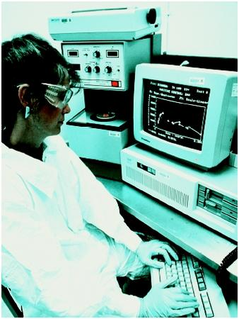 A worker analyzes data at a computer workstation. (U.S. EPA. Reproduced by permission.)