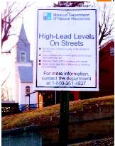 Sign warning residents of high lead levels from Doe Run Smelting. (AP/Wide World Photos. Reproduced by permission.)