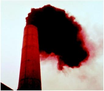 Smoke is pouring from the smokestack of an incinerator. (U.S. EPA.  Reproduced by permission.)
