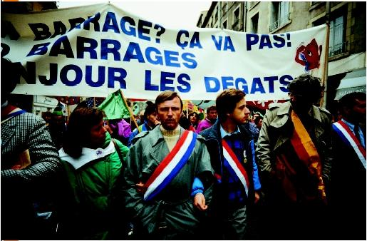 Antoine Waechter (at center), French Green Party member, participating in a demonstration against the building of the Serre de la Fare dam, along the Loire headwaters. (© Bernard Bisson/Corbis. Reproduced by permission.)