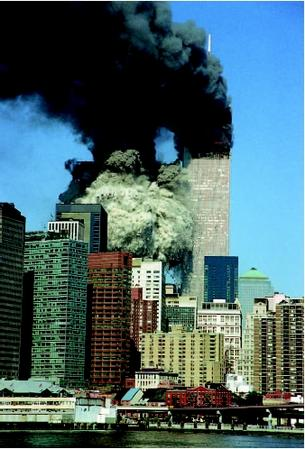 South tower of the World Trade Center collapsing as black smoke billows from the burning north tower following the terrorist attack on September 11, 2001, by members of al-Qaeda. (AP/Wide World Photos. Reproduced by permission.)