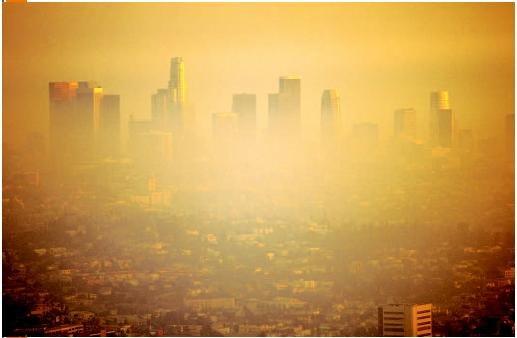 A similar perspective of the Los Angeles skyline, but with much of the scenery obscured by smog. (© Robert Landau/Corbis. Reproduced by permission.)