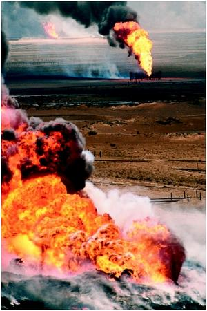 Burning oil wells in Kuwait, which were sabotaged by retreating Iraqi troops at the end of the Persian Gulf War, 1991. (©Peter Turnley/Corbis. Reproduced by permission.)